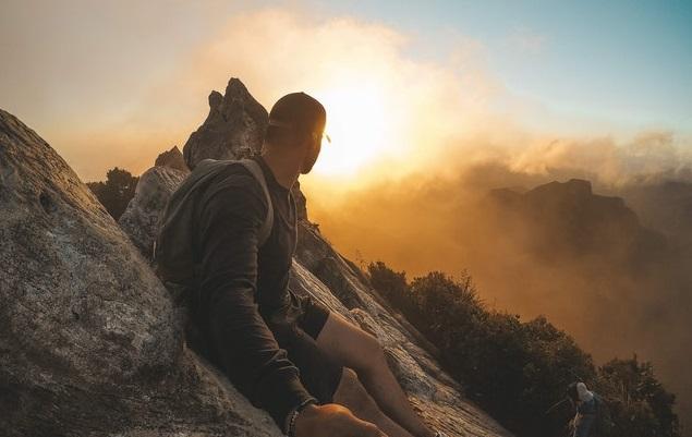 Man Wearing Black Long-sleeved Shirt Standing on Mountain