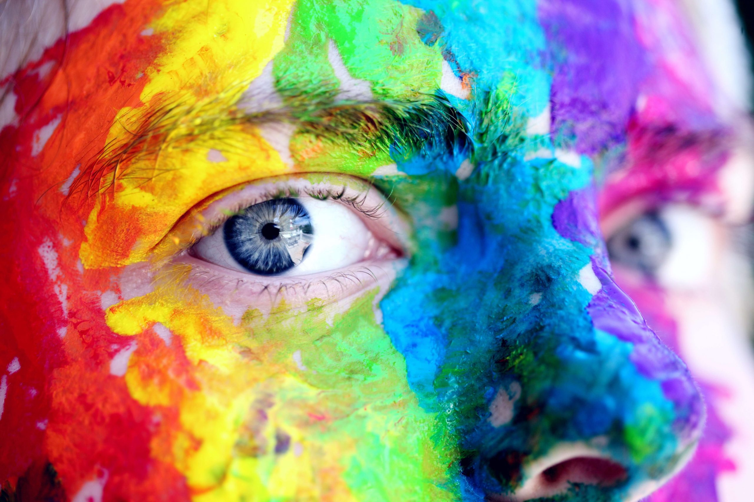 man covered with rainbow paint