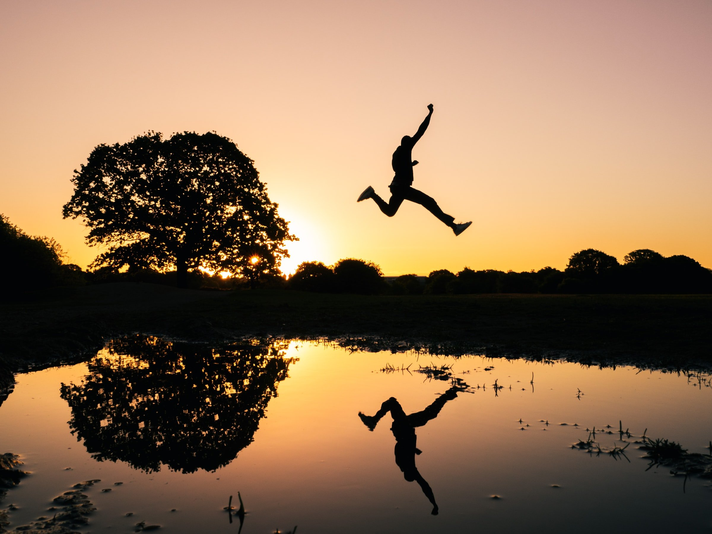 man jumping with reflection