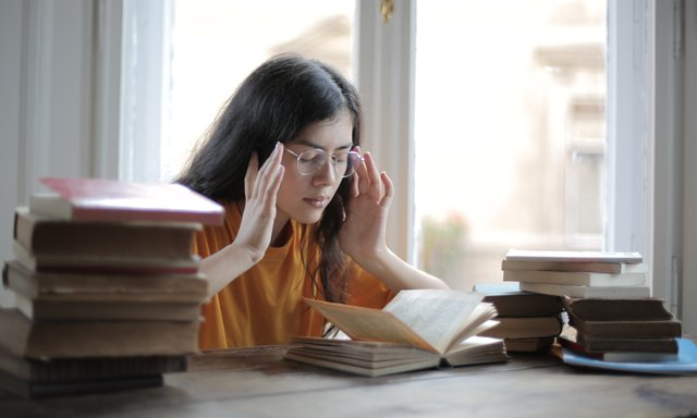 student suffering from headache