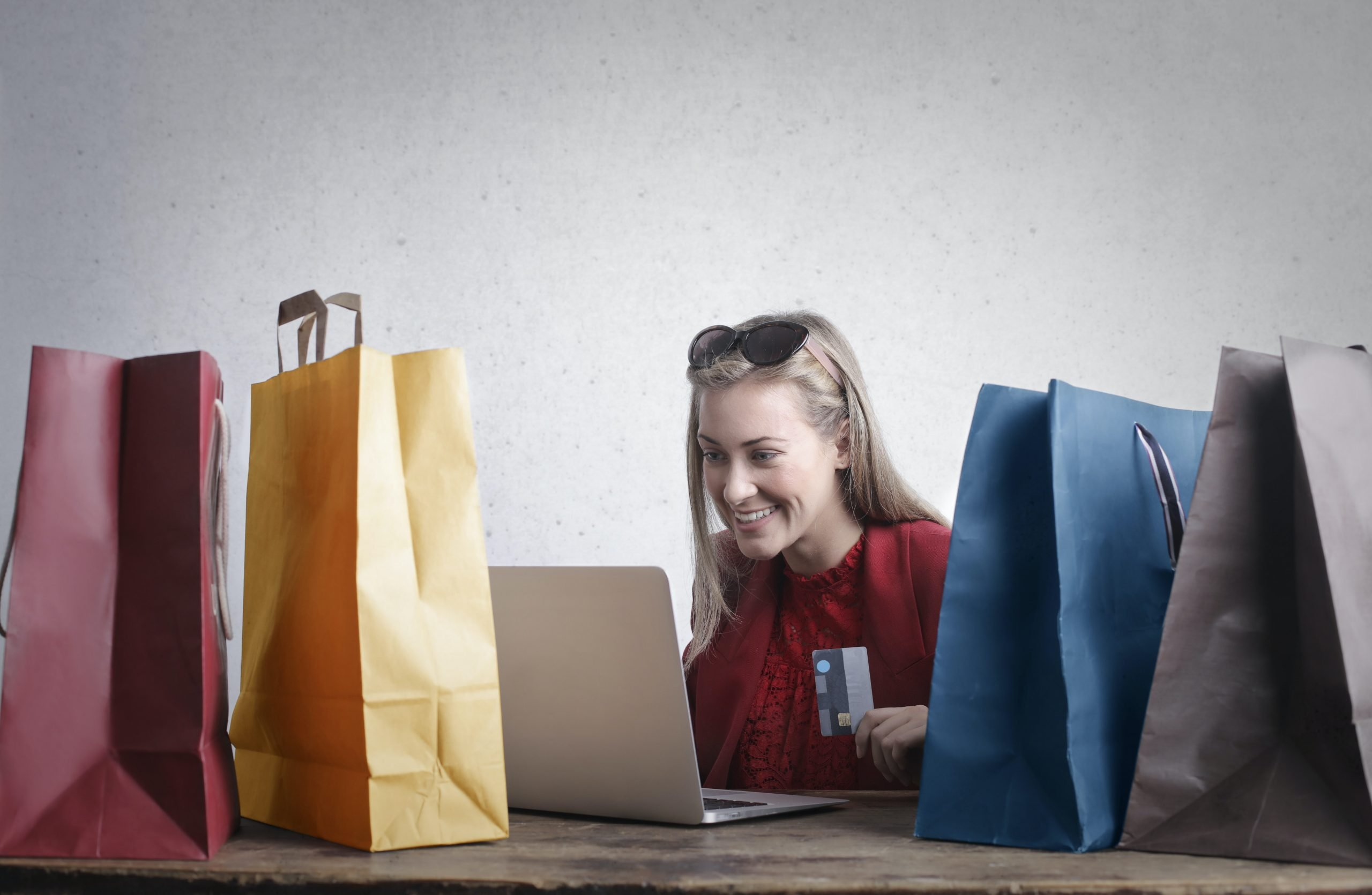 woman buying things online with credit card