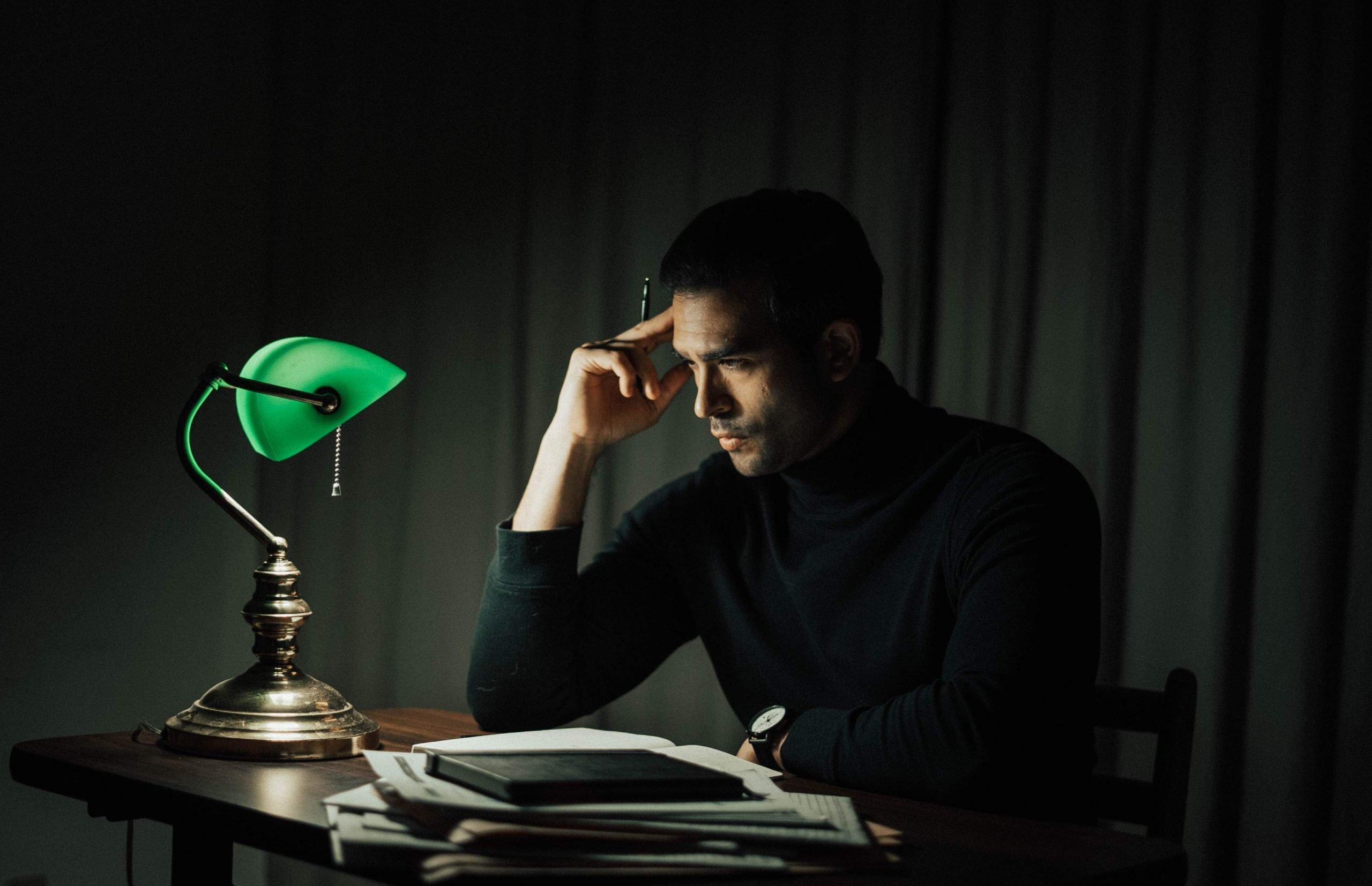 man thinking in the dark