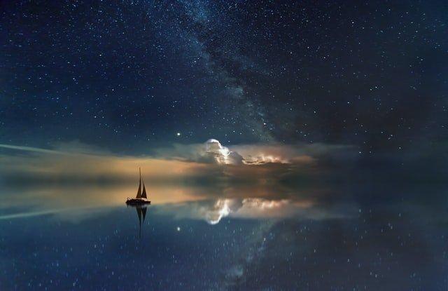 boat sailing in a serene ocean