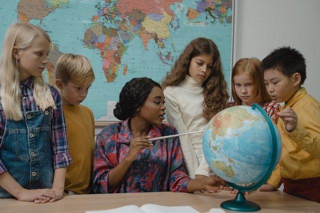 woman teaching a bunch of kids