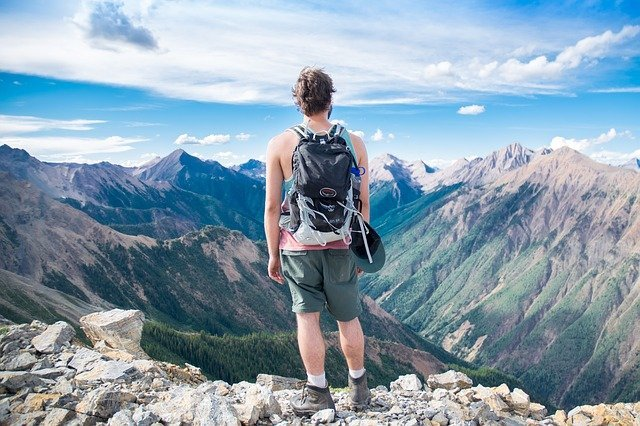man standing above the mountain