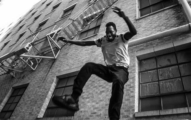man jumping happily