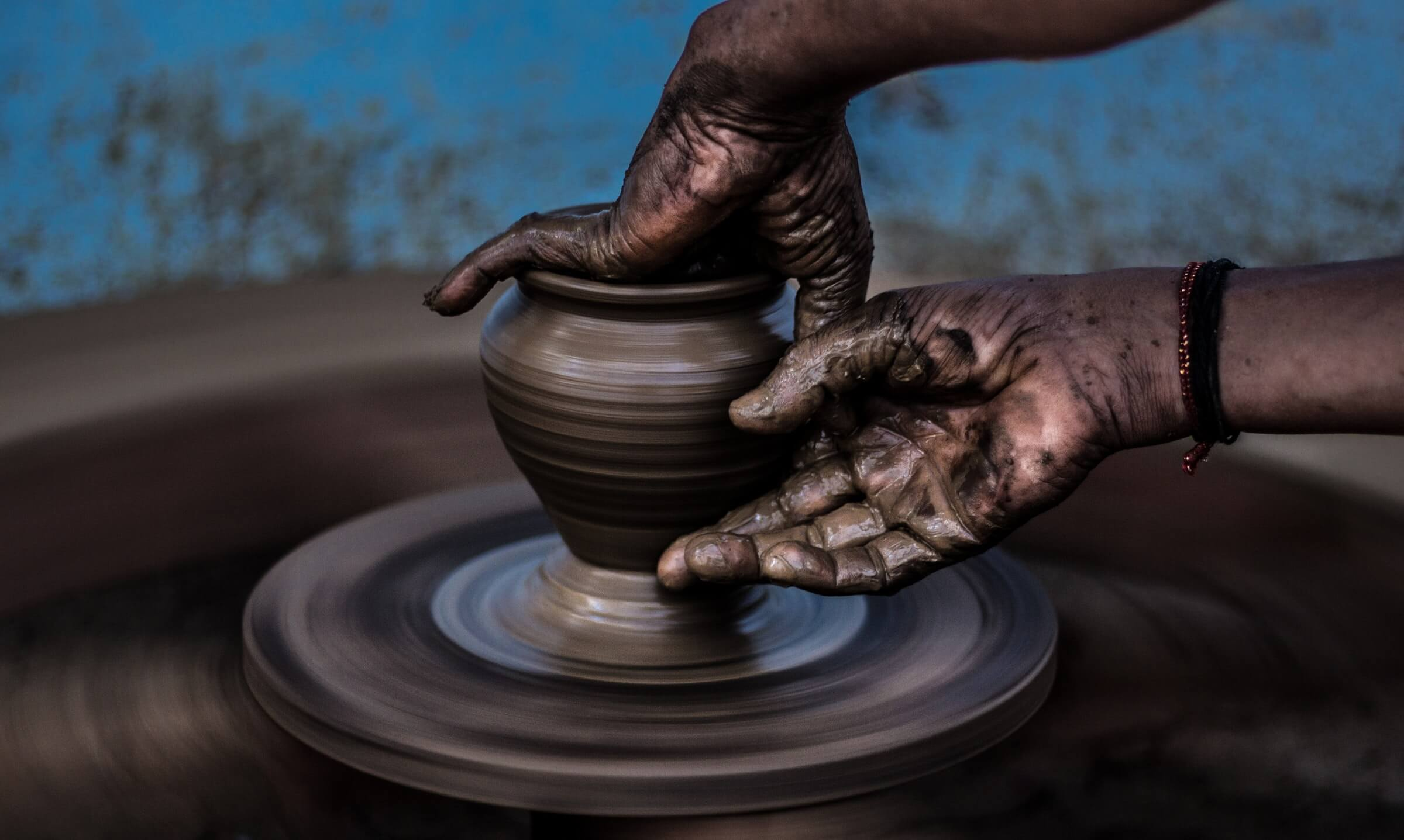 making a pot of clay