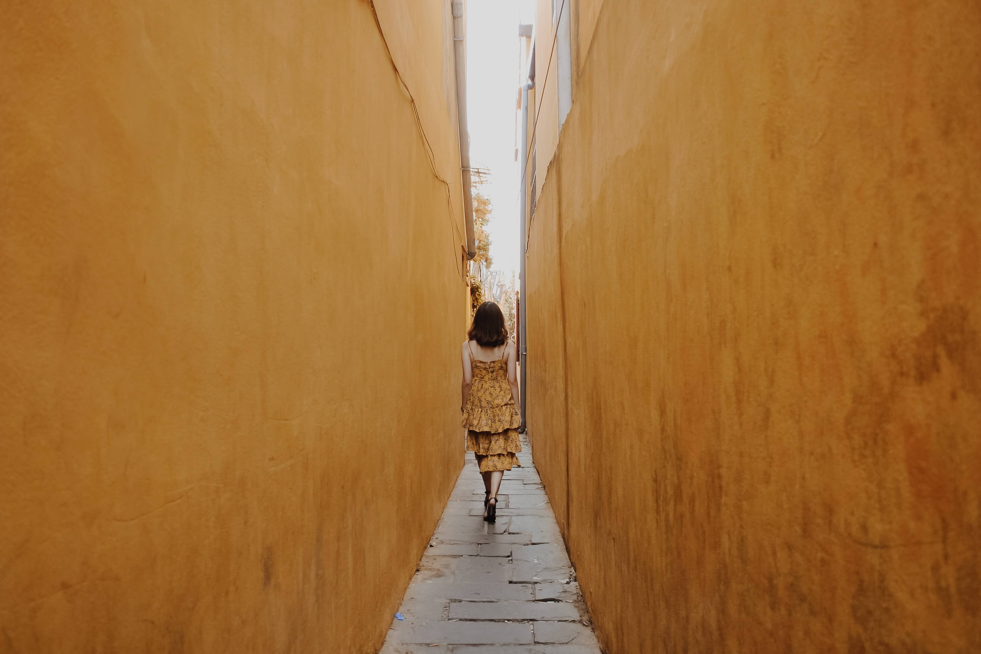 girl walkng along the alleyway