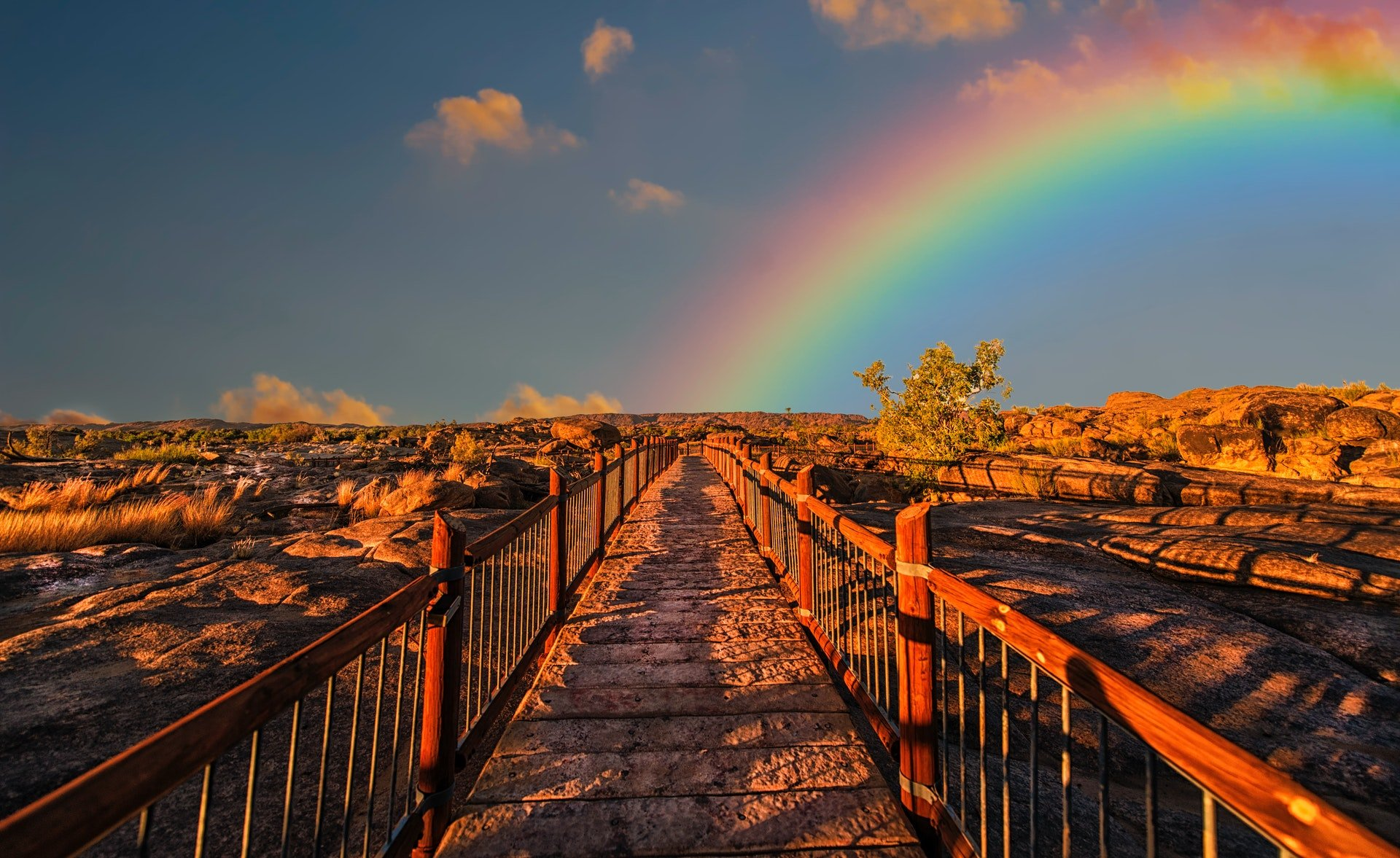 boardwalk with rainbow in the distance