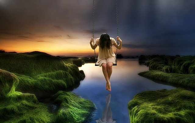 girl in a swing looking down