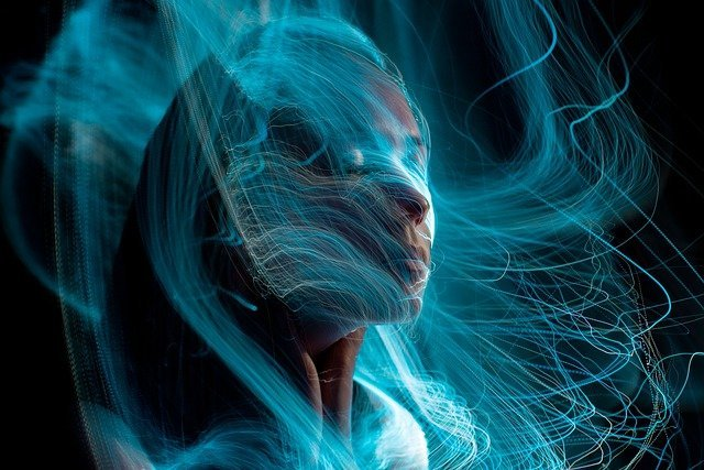 woman surrounded with light lines
