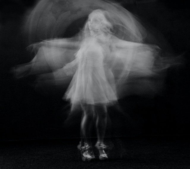 girl floating with white shadows arround