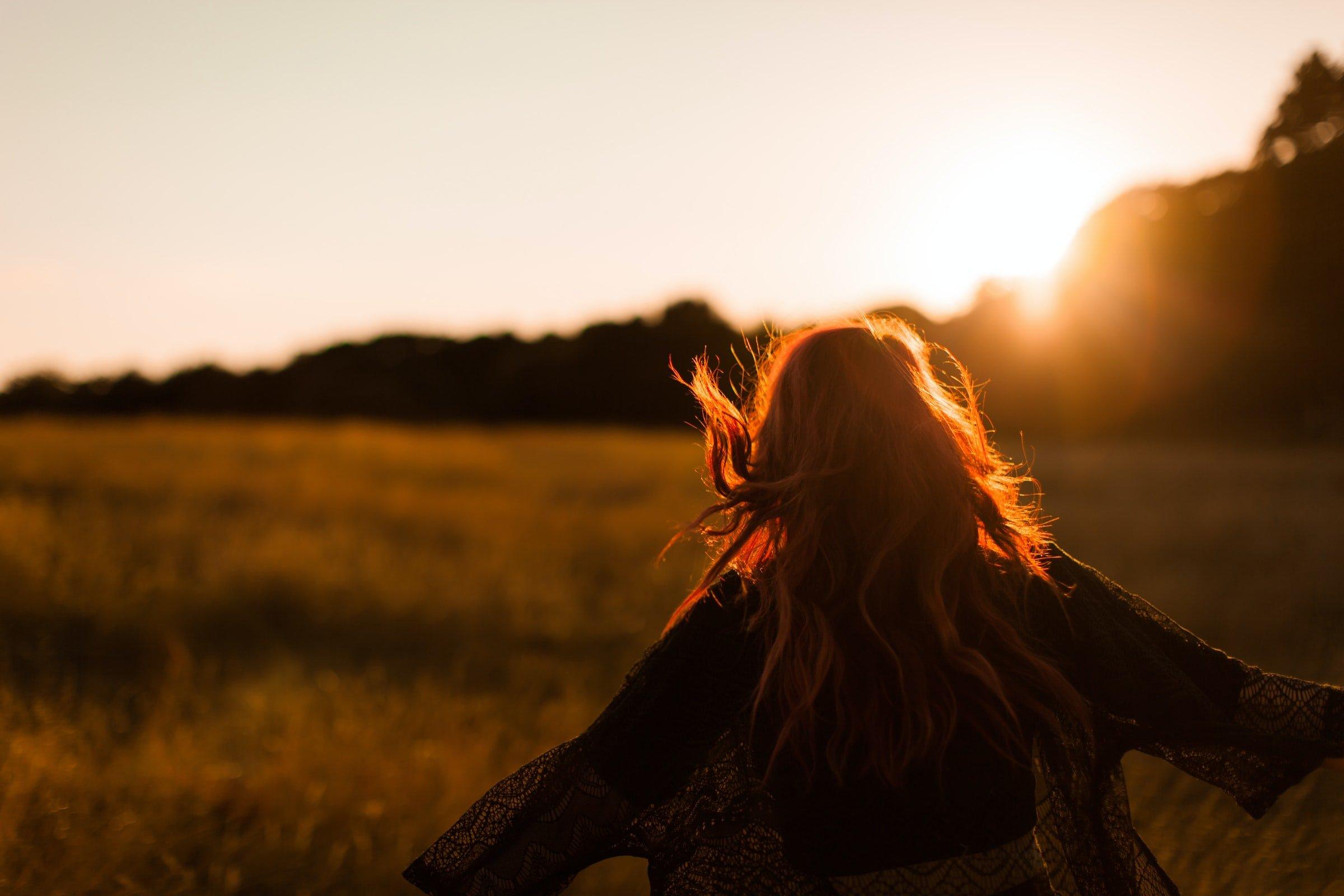 woman running around with sunlight on
