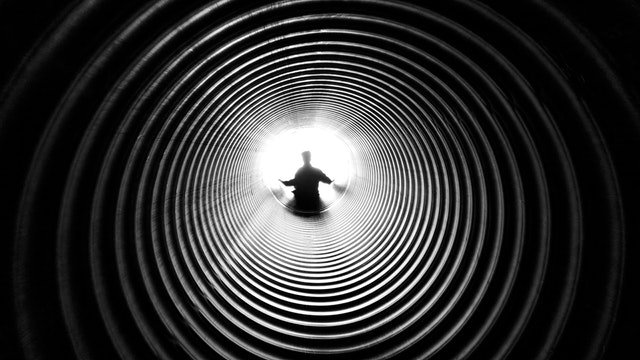person at the end of tunnel