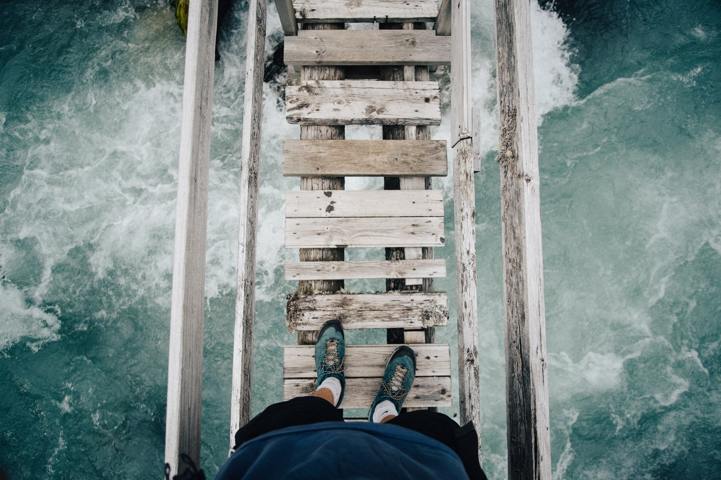 feets trying to step on a bridge