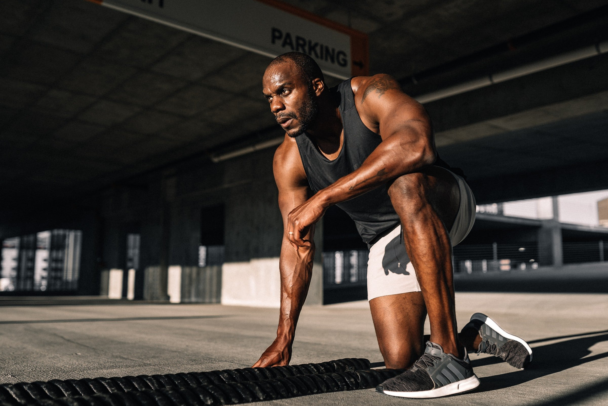 man resting while sweating while working out