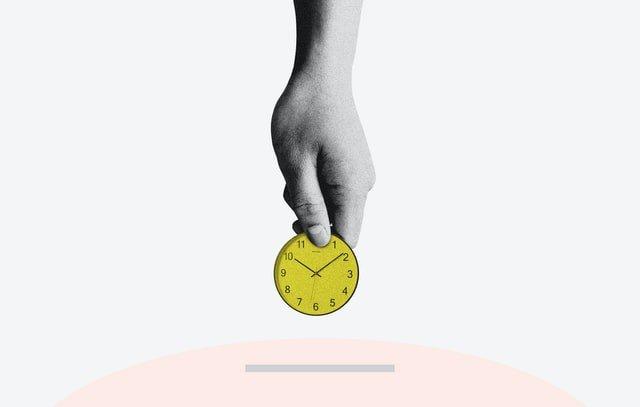 hand holding a golden watch