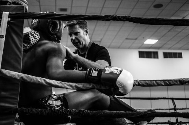 coach shouting at a boxer