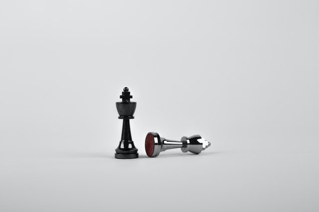 black and silver chess pieces