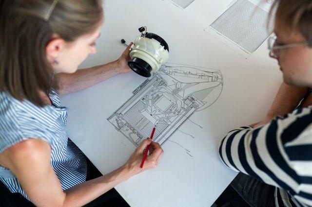 woman designing an equipment