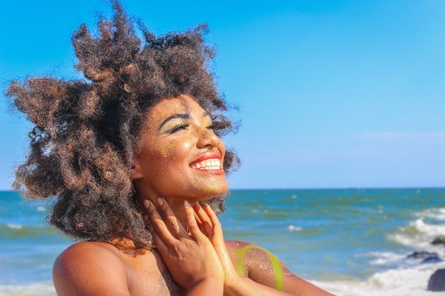 Close-Up Photo of Woman With Afro Hair