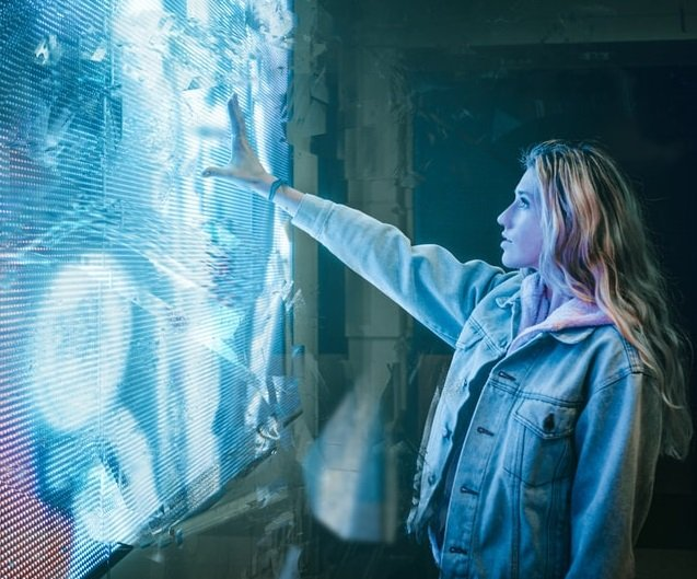 woman in front of the wall with blue light