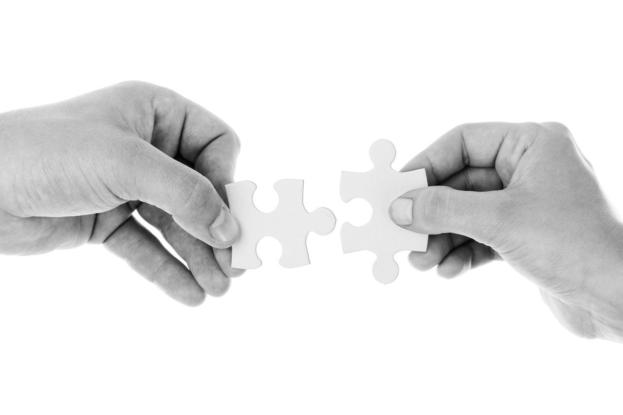 jigsaw puzzle pieces being connected