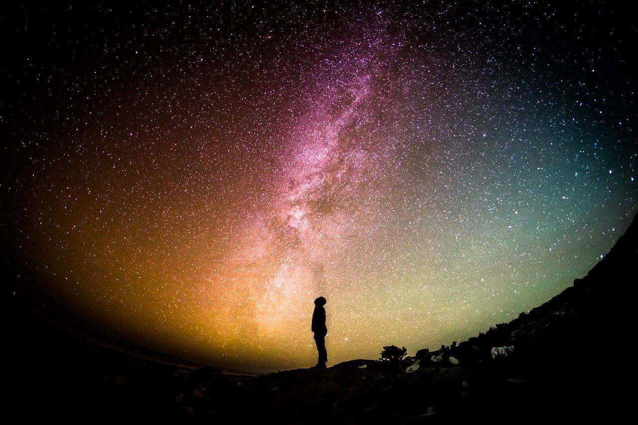 man looking up at the milky way
