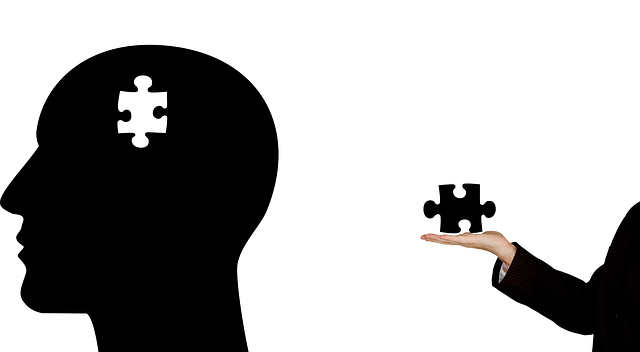 head of a man losing a puzzle piece