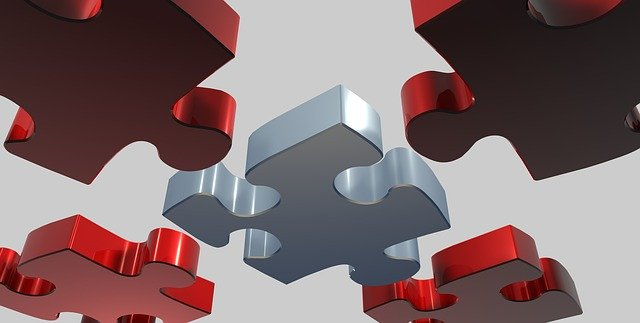 puzzle pieces being brought together