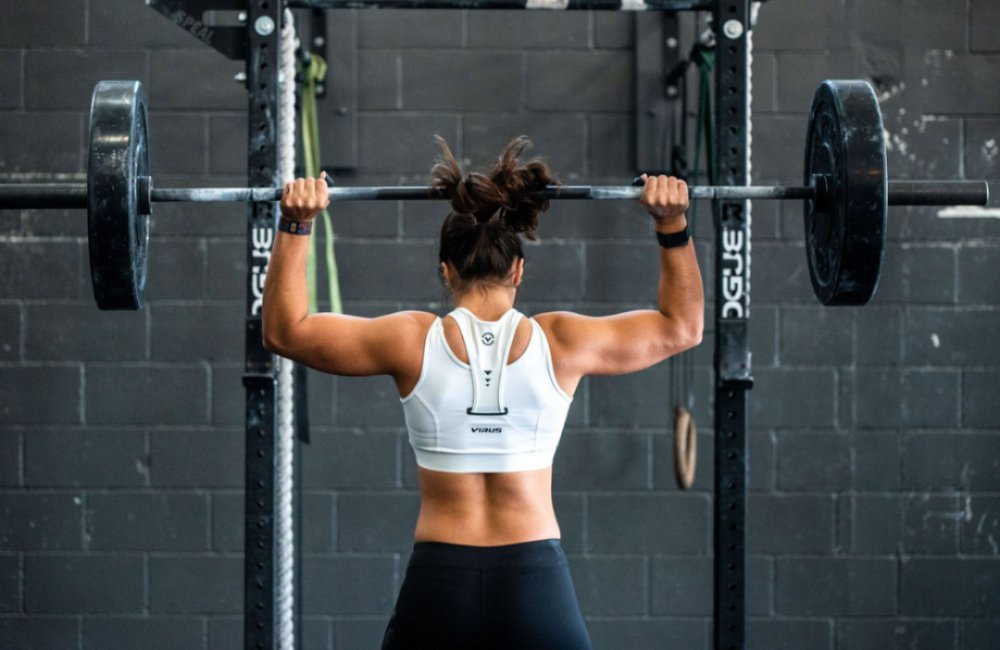 girl carrying a barbell
