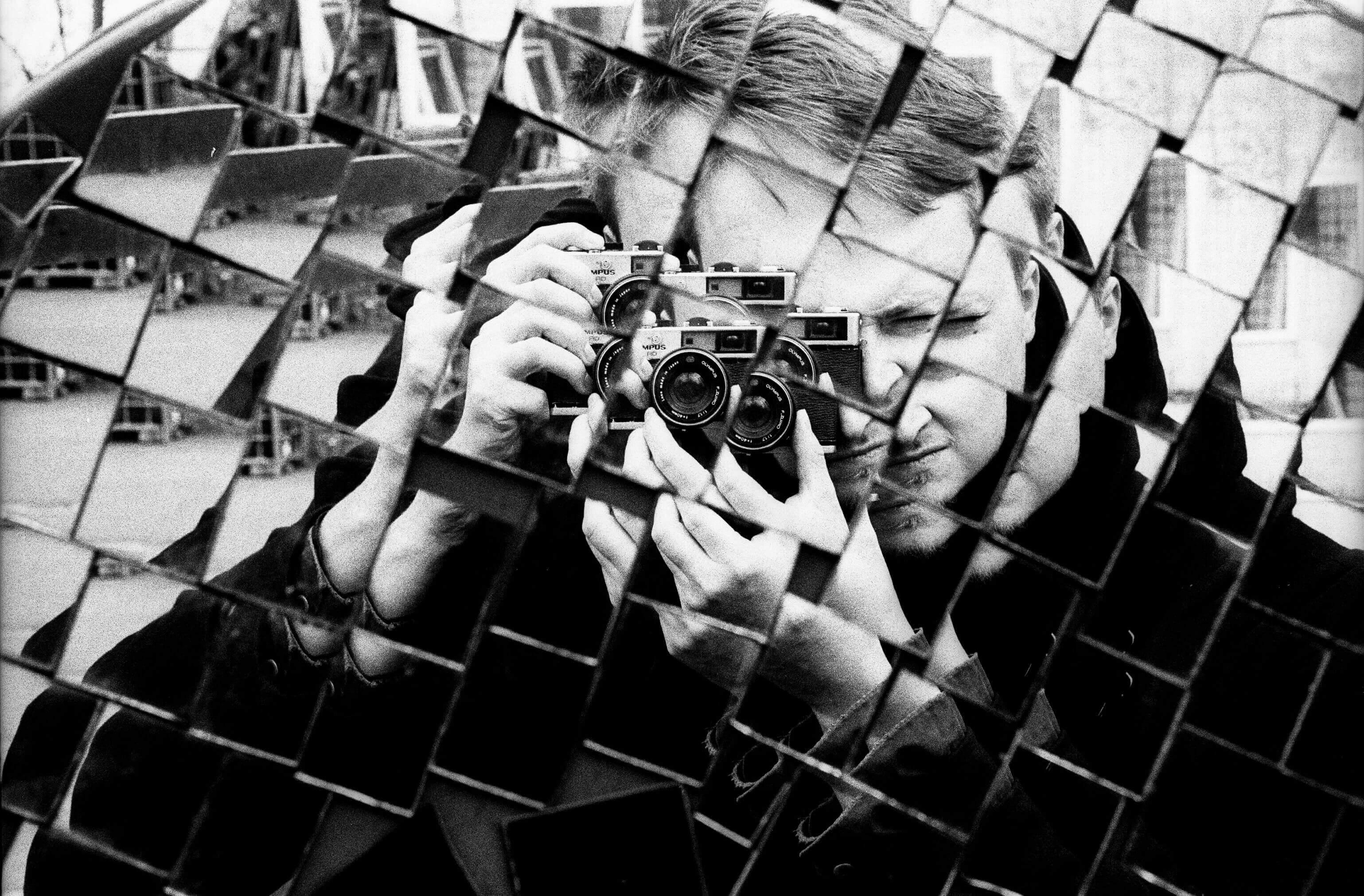 reflection of a man wtih camera