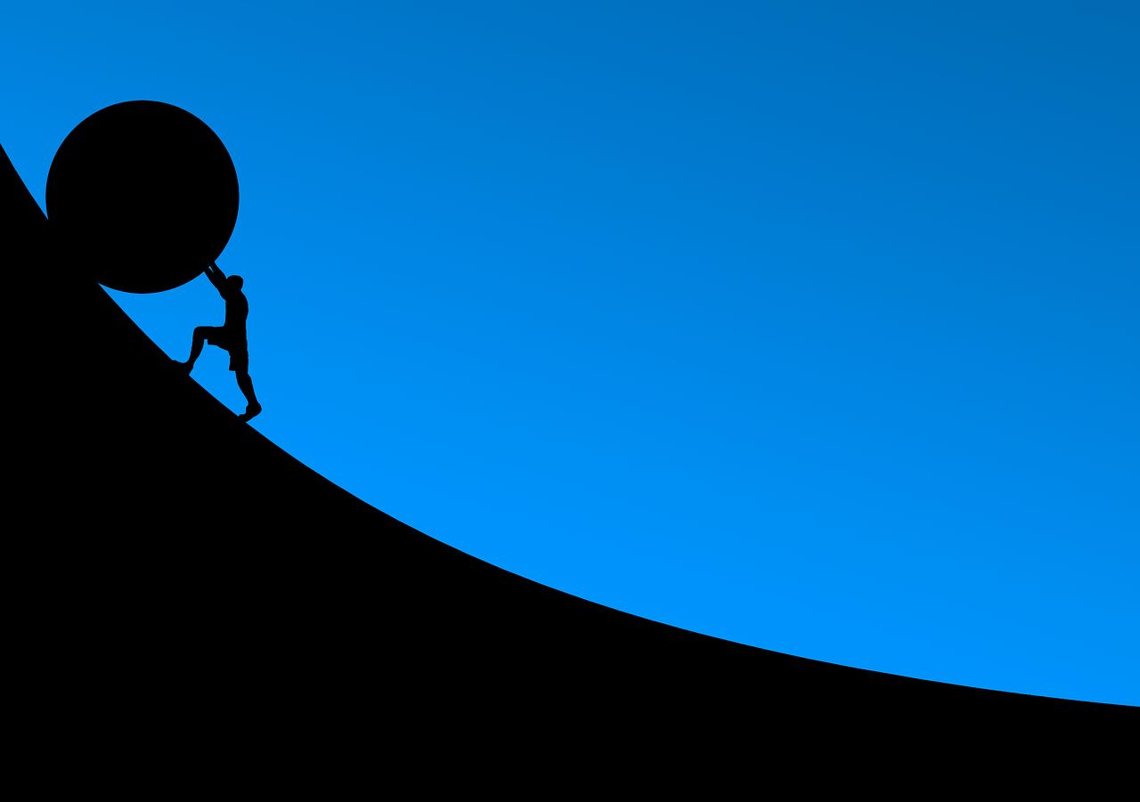 man pushing boulder