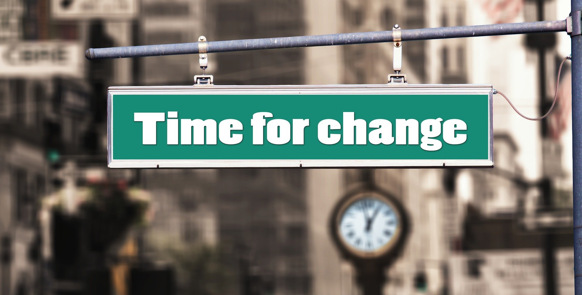 street sign with time for change words
