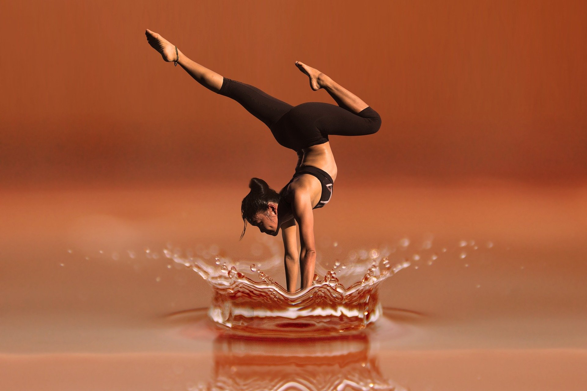 yoga pose above water ripples