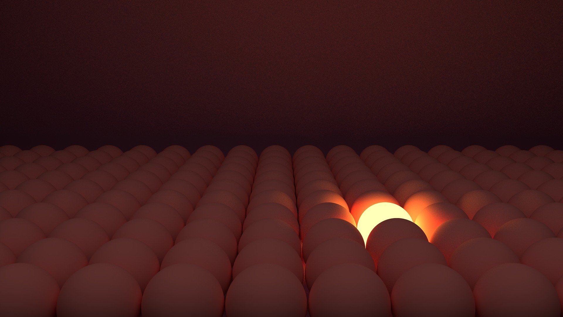 one lighted egg in a crowd of eggs