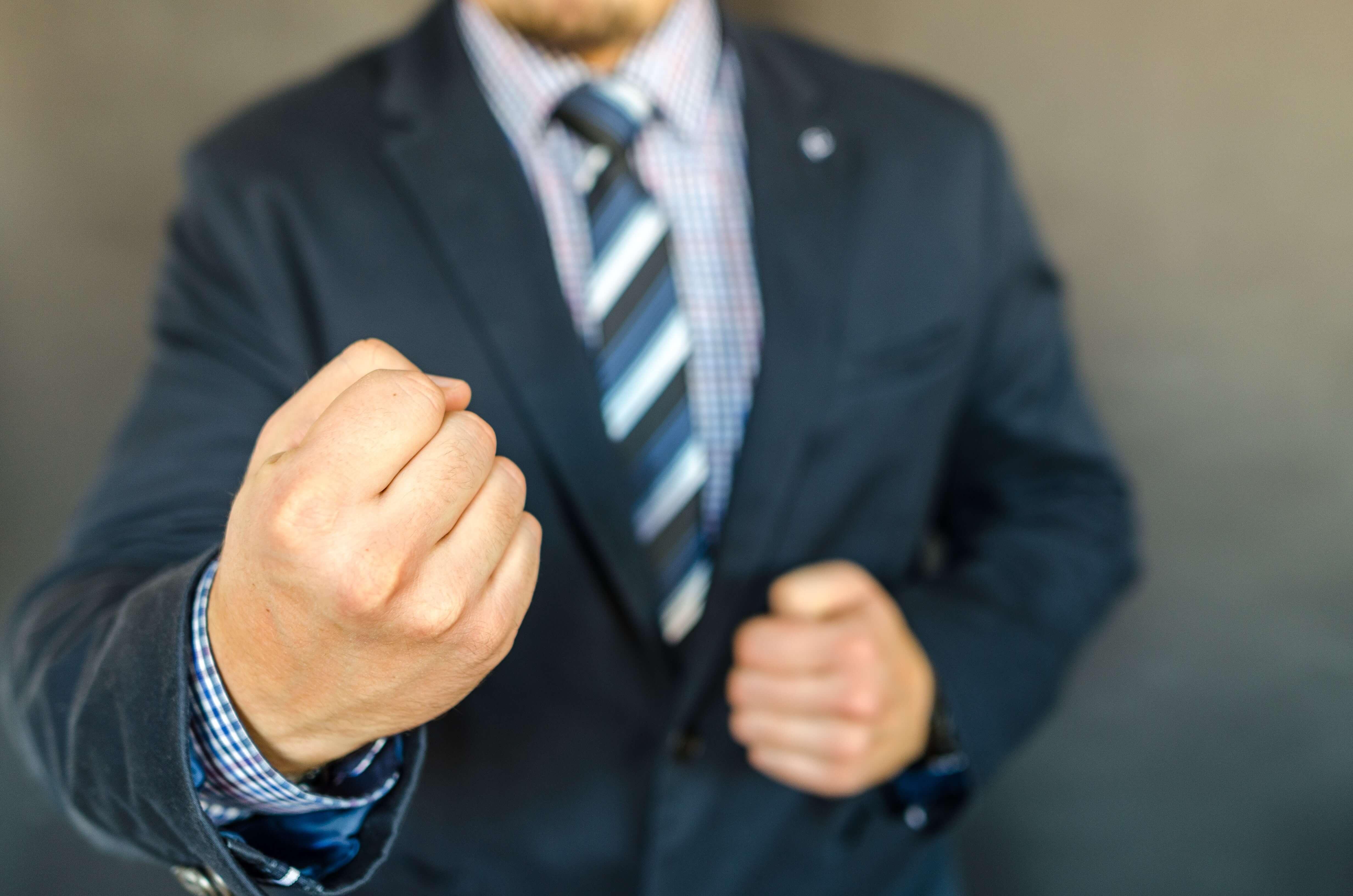 man clenching his fist forward