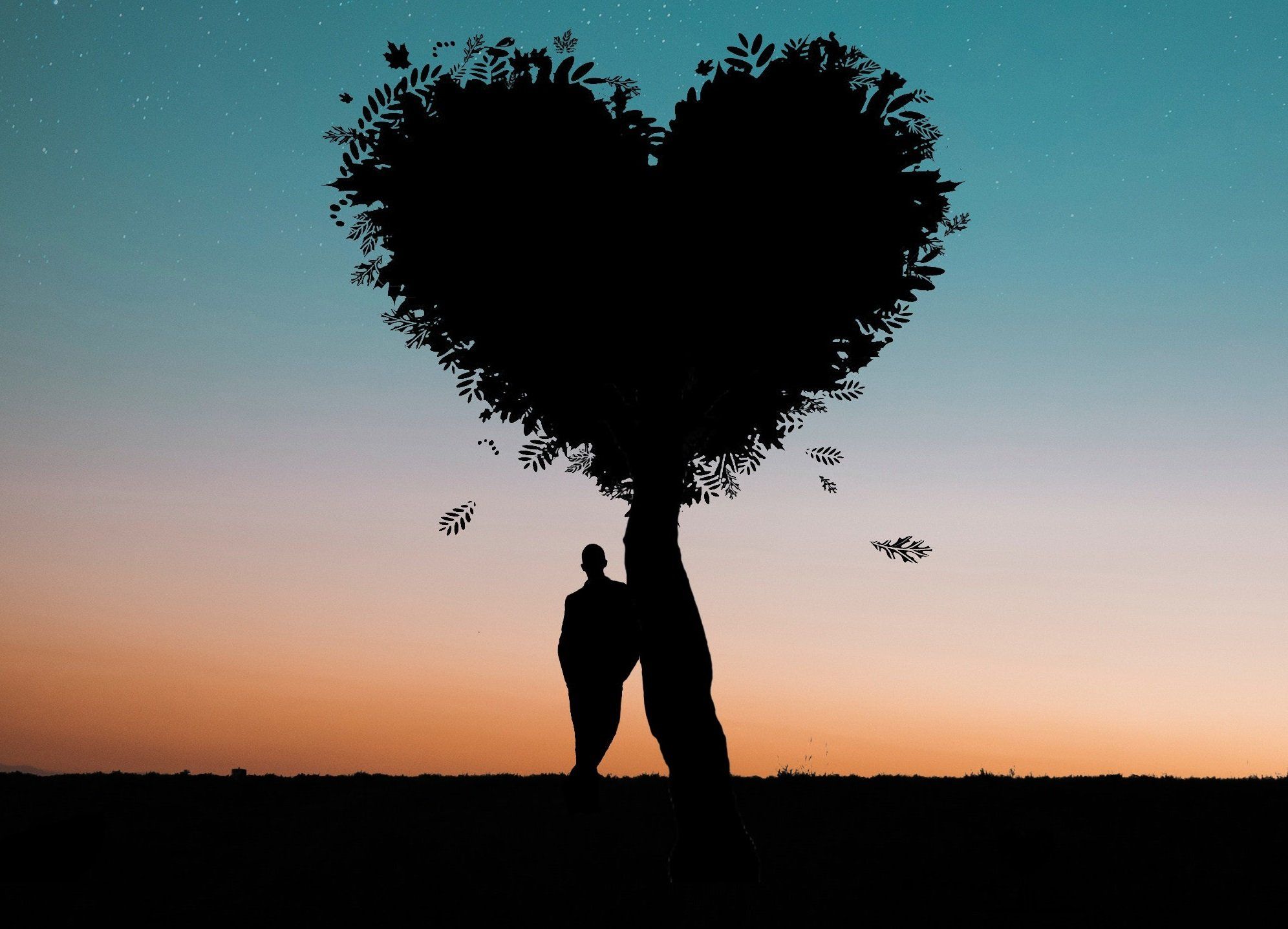 man leaning on heart shaped tree