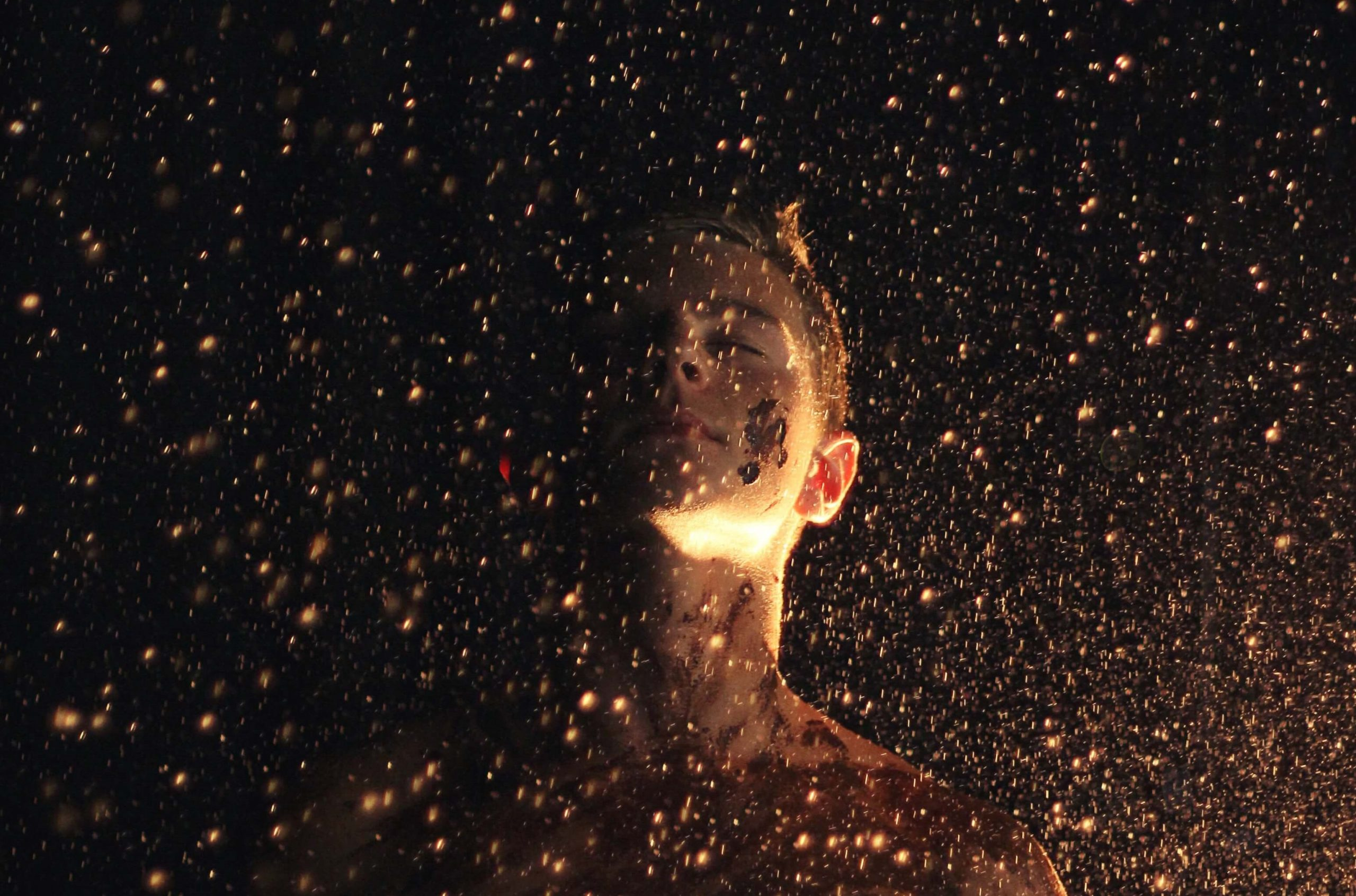 woman being surrounded with dust and confettis
