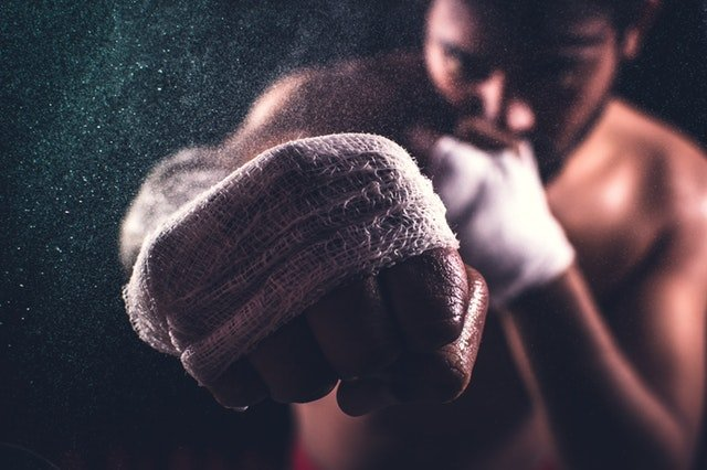 boxer drawing his fist near the camera