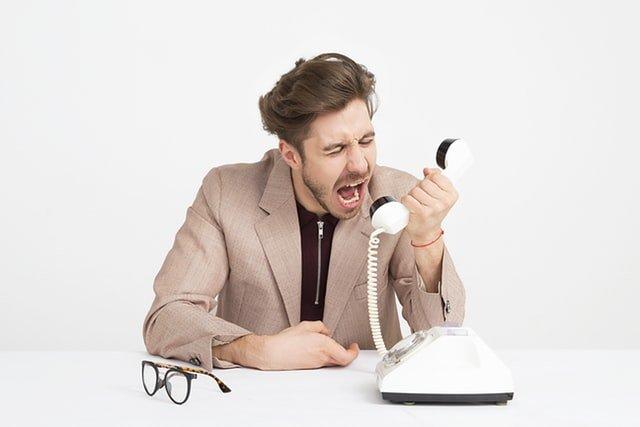 man angry shouting at the phone
