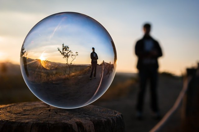 glass ball with the reflection of a man