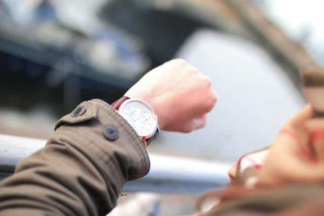 person watching wrist watch