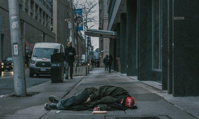 man sleeping in the street