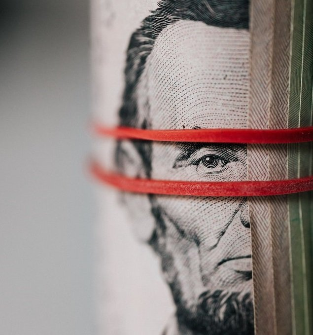 rolls of dollar bills with elastic