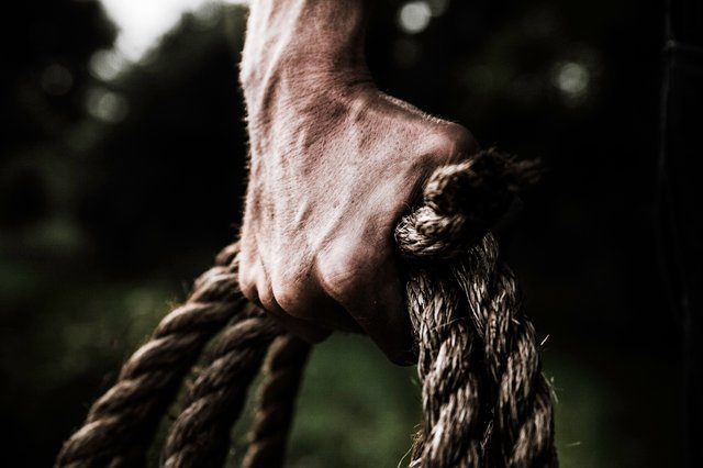 person holding a rope