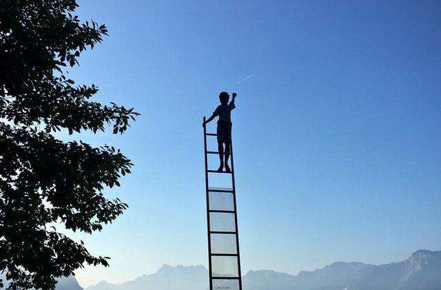 boy-climbing-a-ladder