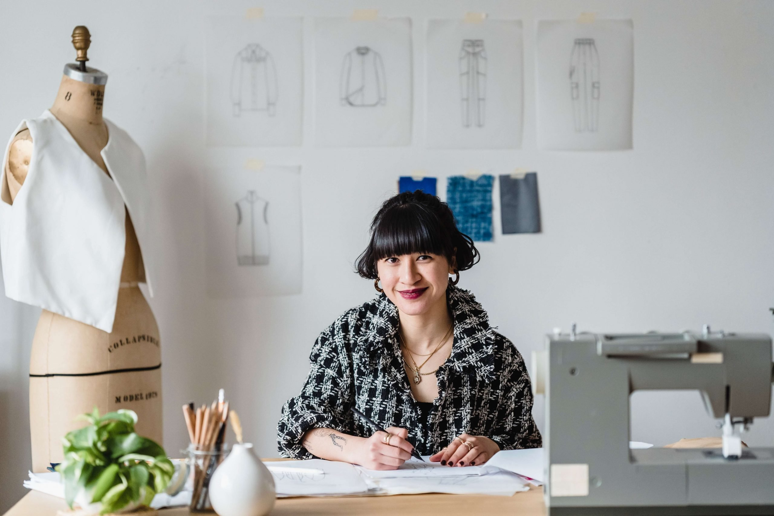 woman working on a desk smiling